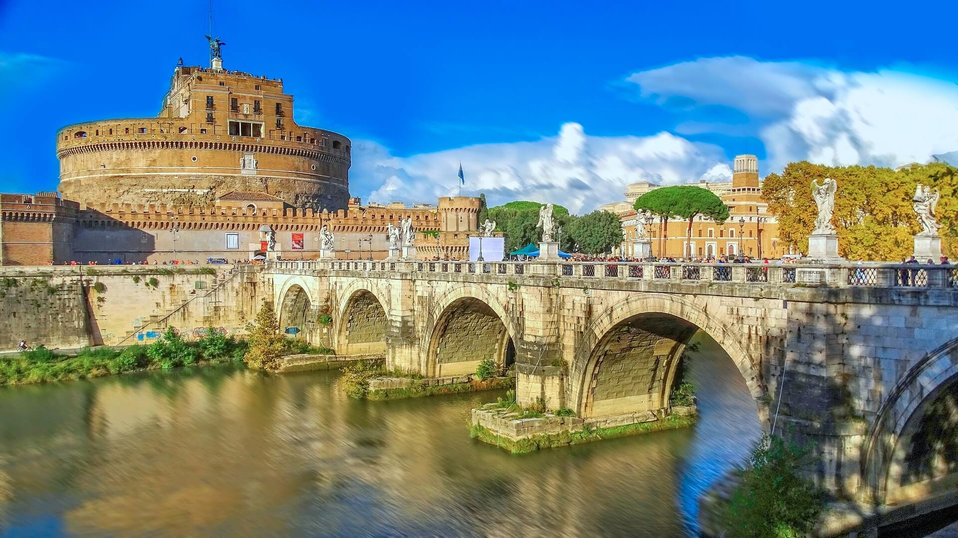 In this picture, you will see the Castel Sant Angelo which is a cylindrical building with a bridge in front of it