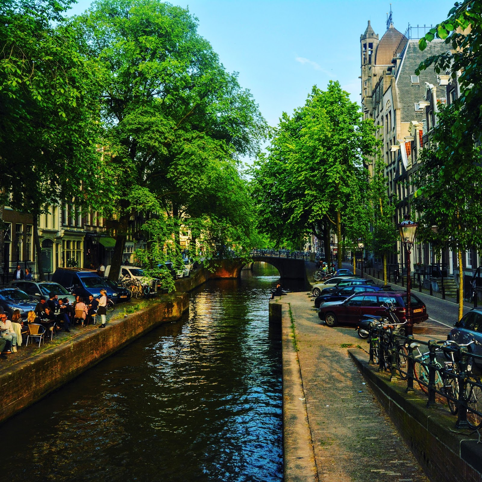 A photo of the canals in Amsterdam flanked by a restaurant on one side from the post 'planning a Europe Trip from India'