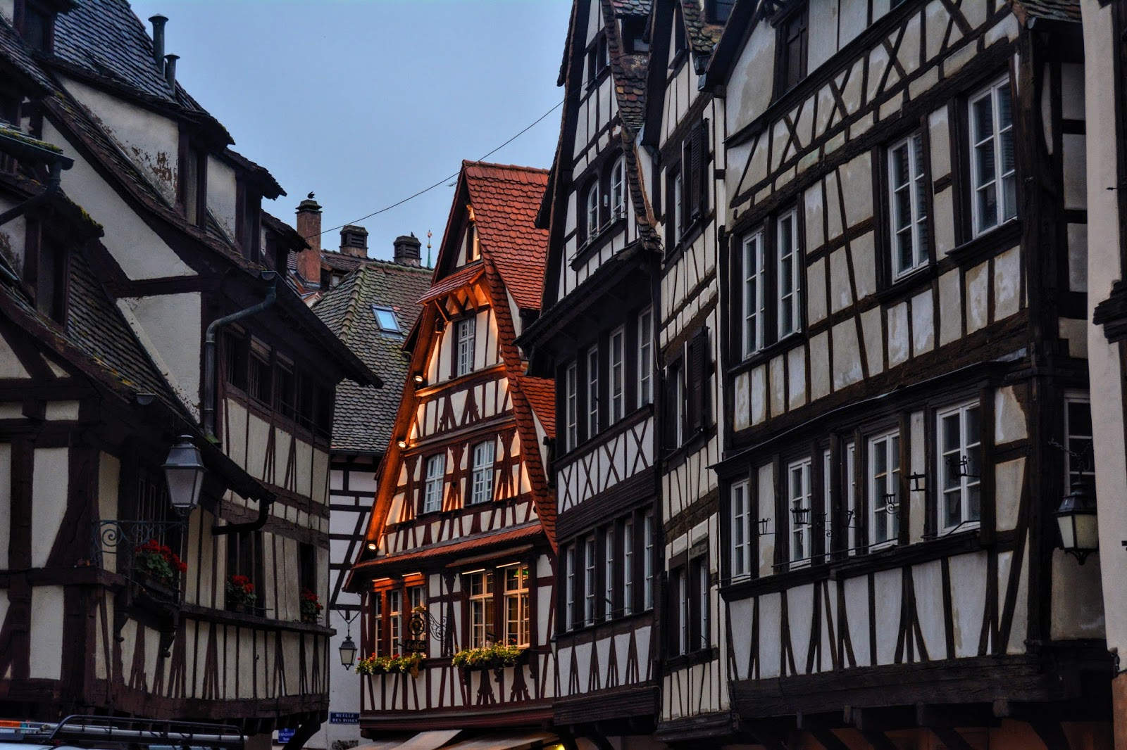This is a photo of brown and black timbered houses in Strasbourg, France from the post 'How to plan Your Eurotrip'