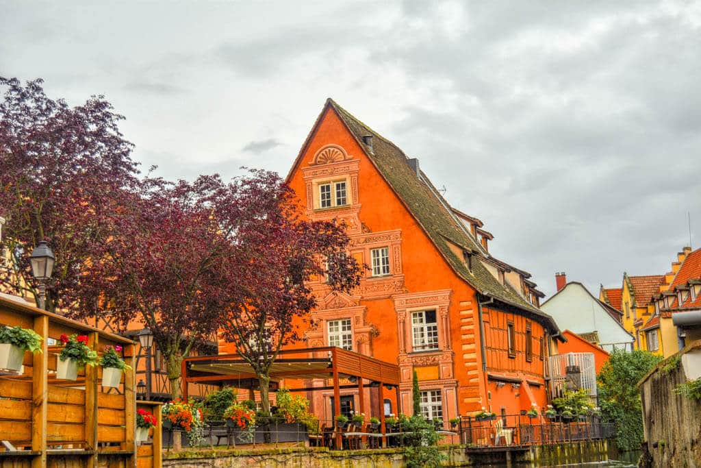 An orange decorative house in Colmar, France