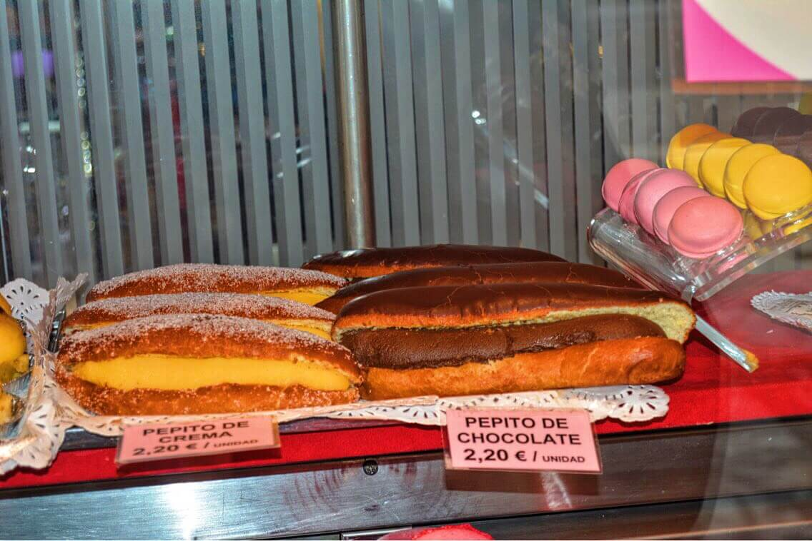 A chocolate shop window with different types of eclairs