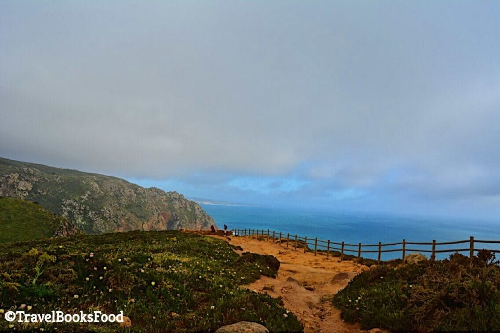 This is a photo of Cabo Da Roca, the western most point of Continental Europe. You see the cliffs hugging the clouds with the sea in the distance