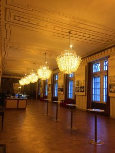 Many Chandeliers inside a hall inside the Vienna Opera House