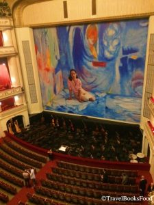 This is a photo of the big hall in Vienna Opera House, Austria. The entire decor is in red