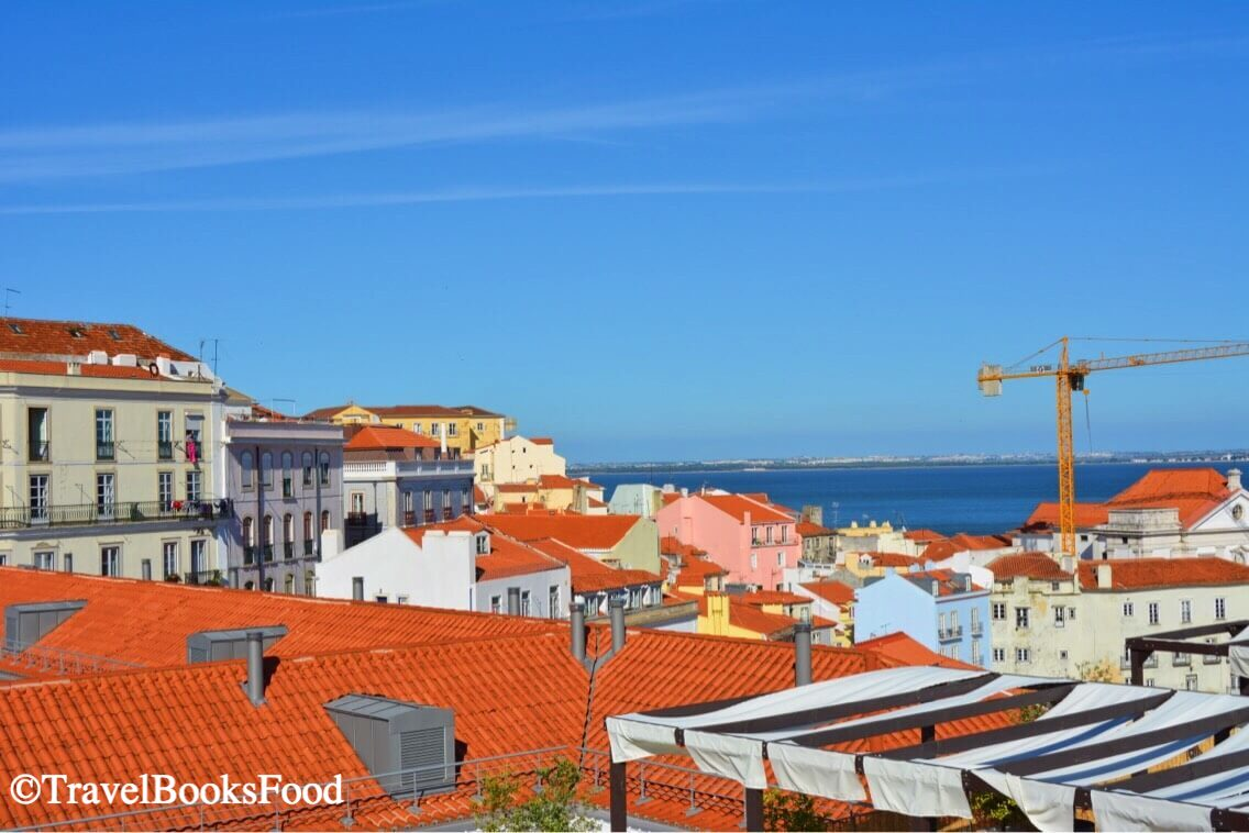This is one of the many viewpoints in Lisbon. Here you can see the view of many houses with a water body in the background