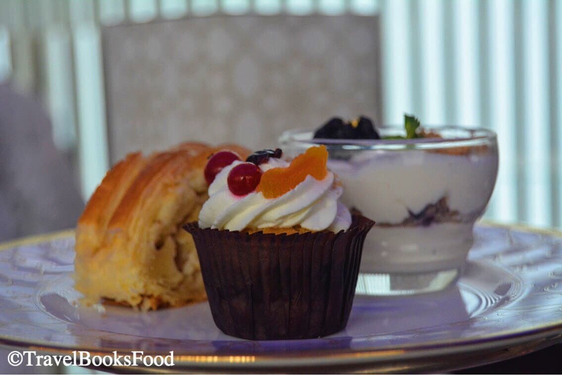 A photo of 3 desserts served at Ritz Carlton in Bangalore; a cupcake, a pastry and a triffle