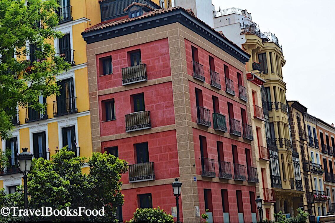 Madrid is full of colorful buildings and this is a photo of a pink, yellow and other buildings
