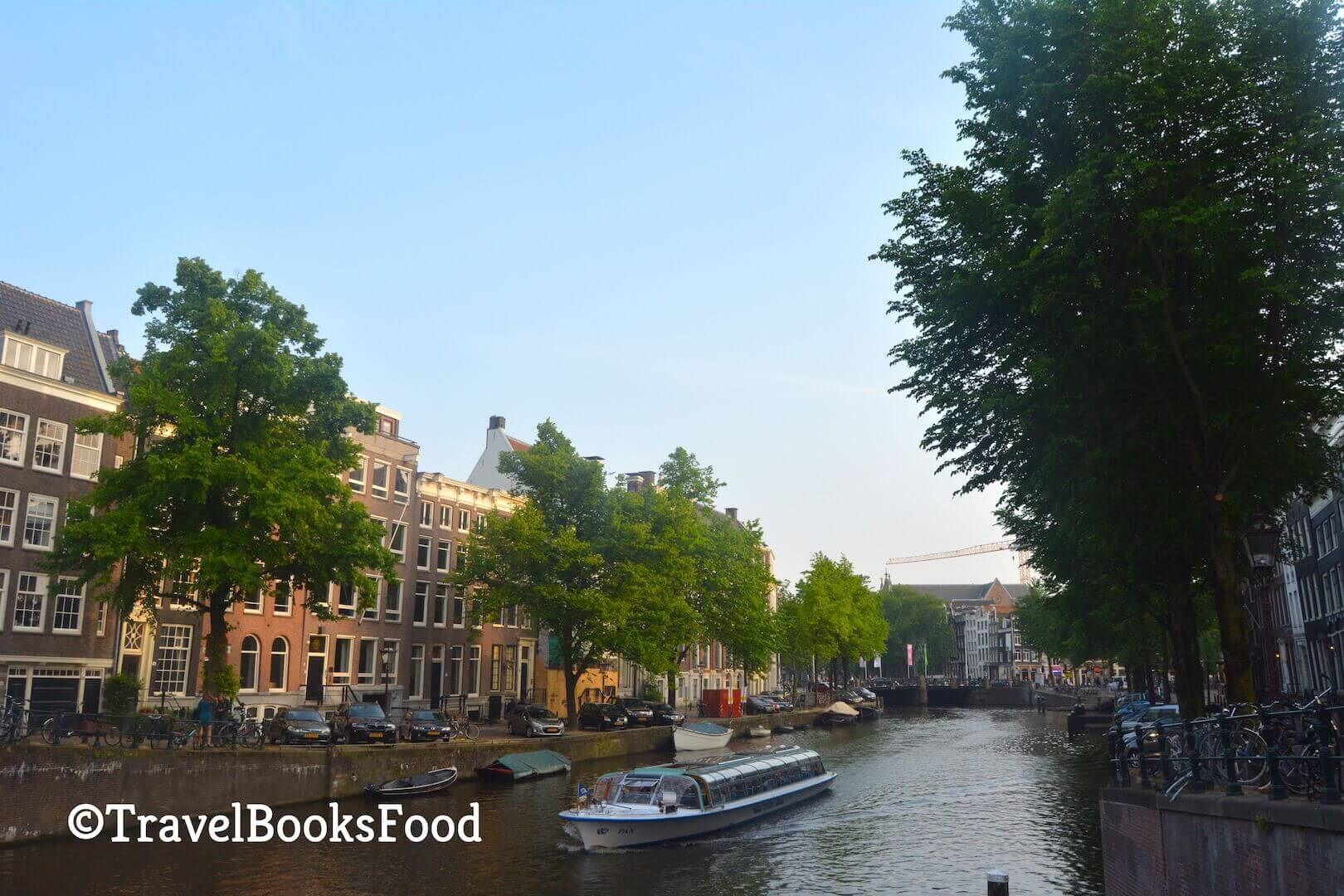 A photo of the famous Amsterdam canals with houses and trees on both sides