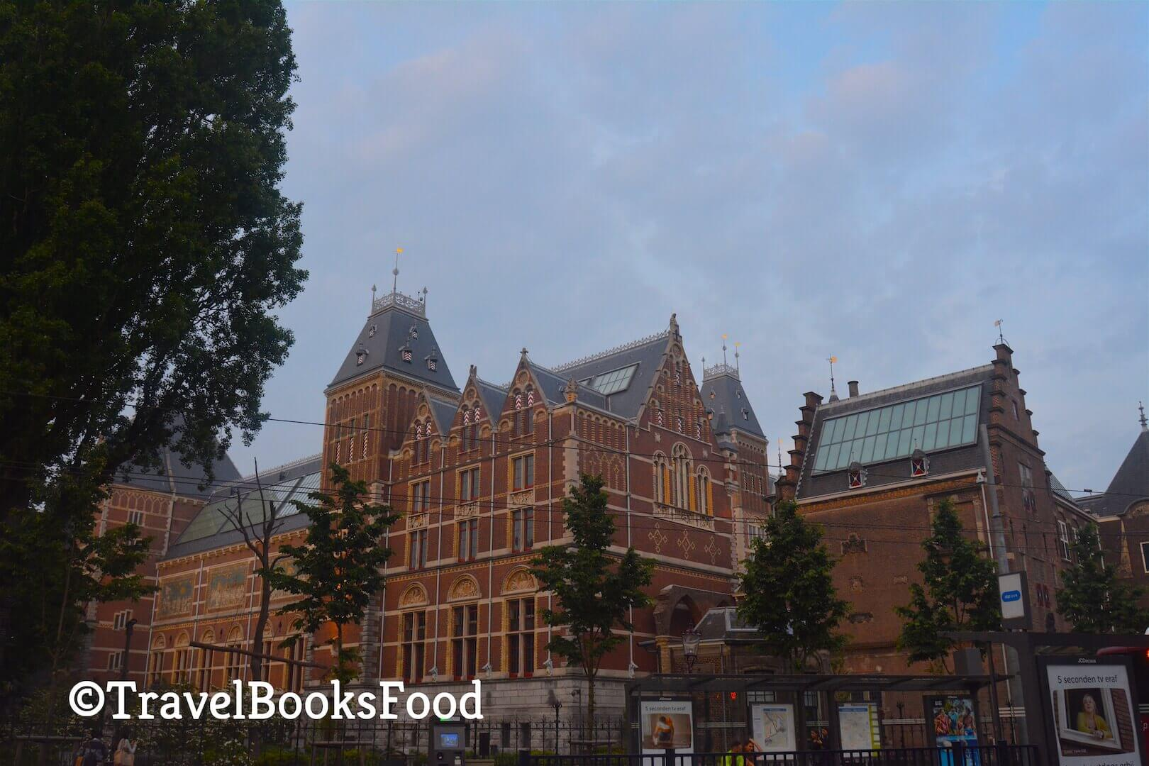This is a photo of Rijksmuseum in Amsterdam. This is a big looking orangish brown building