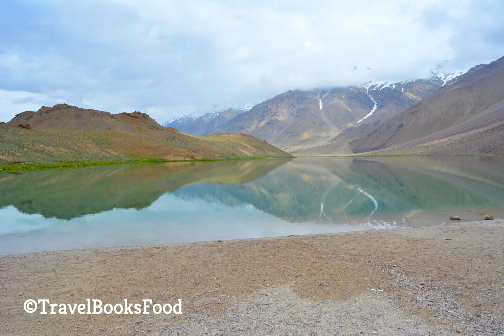 A beautiful lake, Chandrataal lake in the middle of many mountains