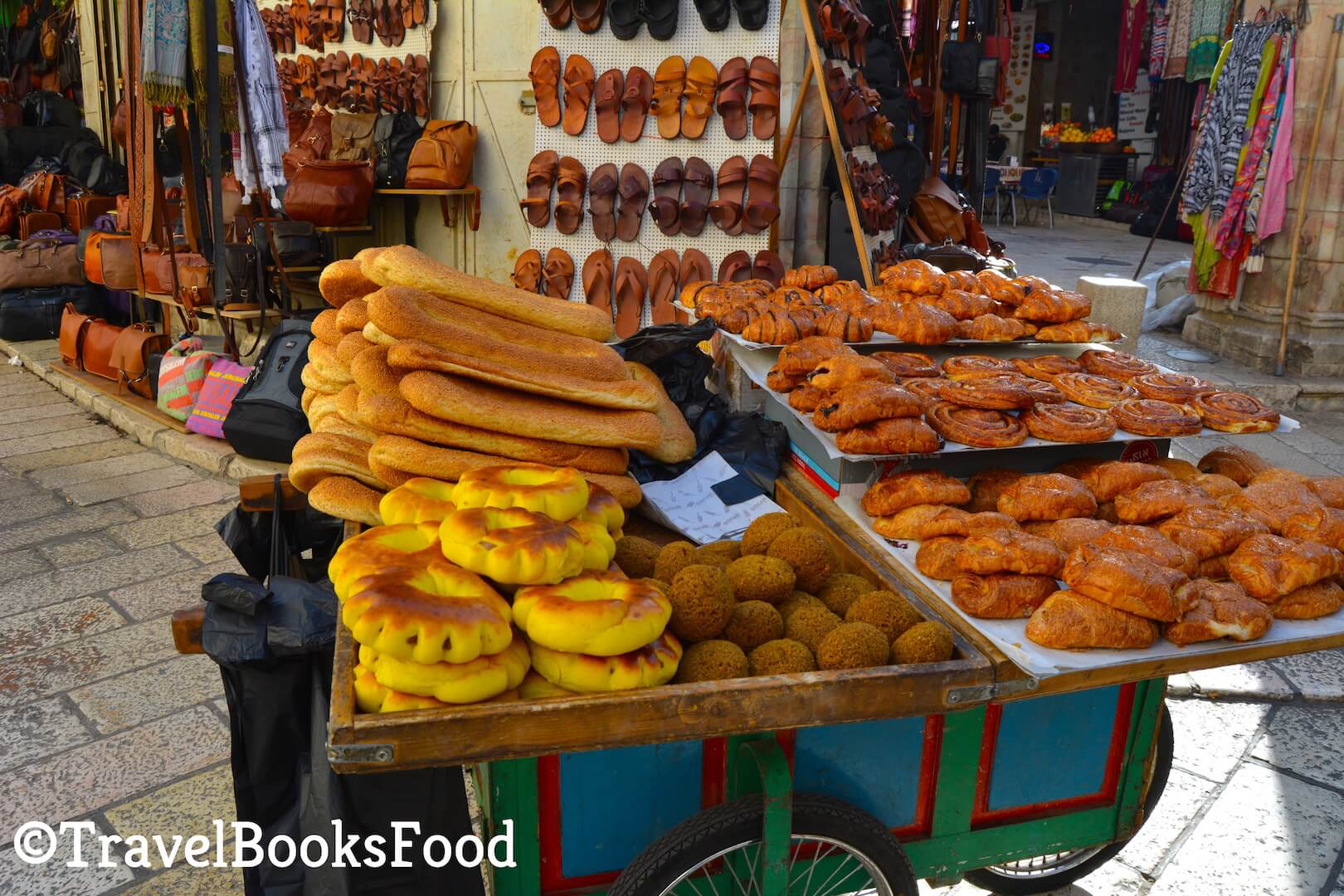 A street food cart with different types of bread and other vegetarian delicacies in Jerusalem, Israel