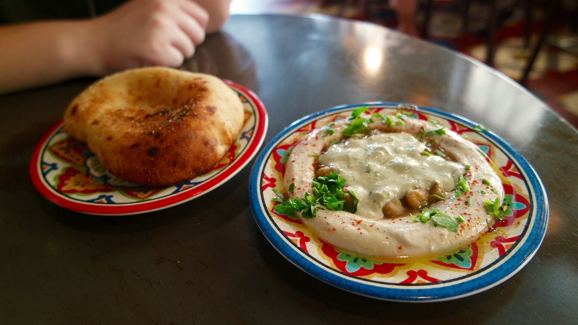 A photo of an Israeli food combination of Hummus and Pita