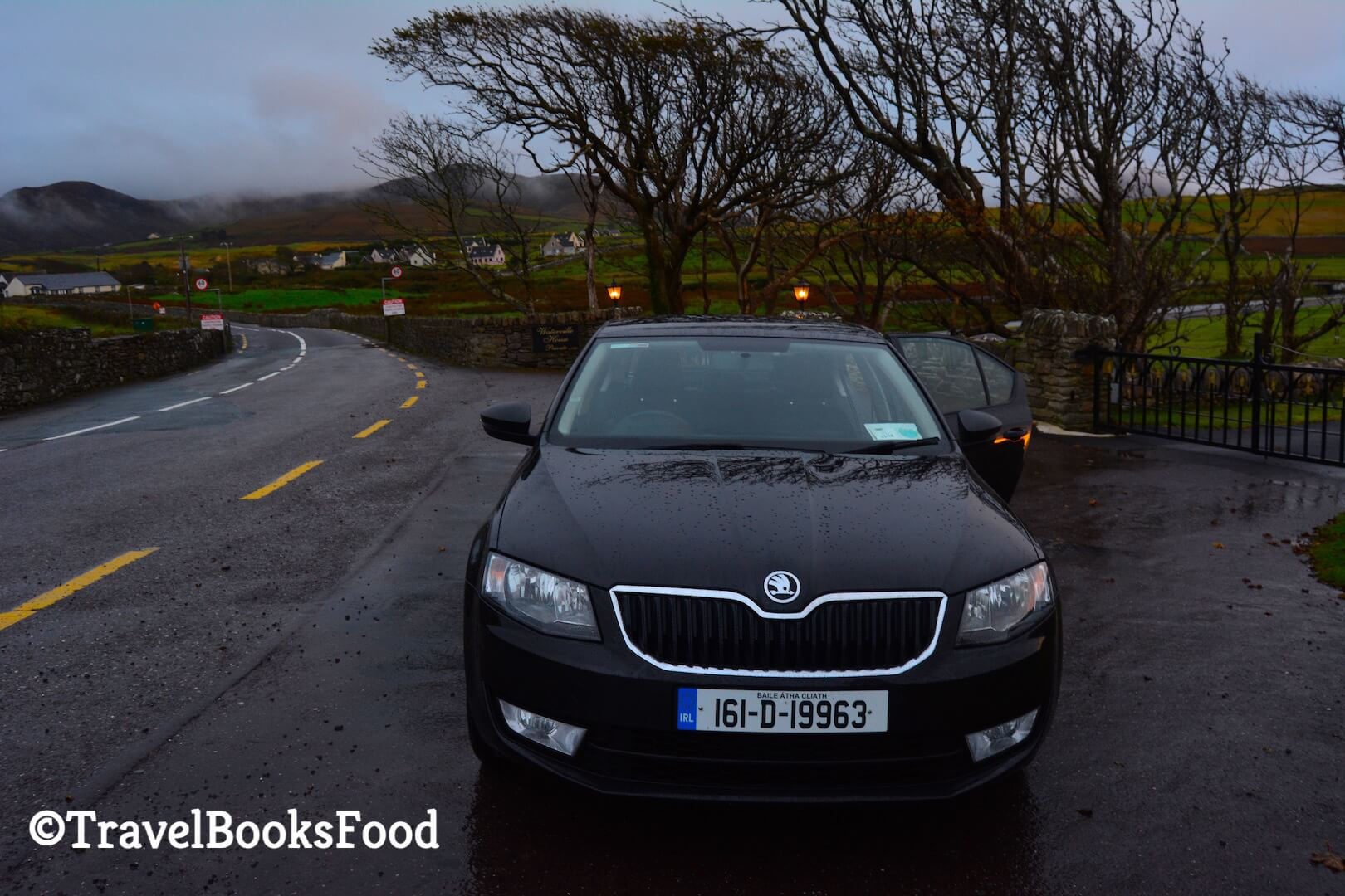 Photo of our Skoda Saloon car we drove around Ireland with a gorgeous eerie background
