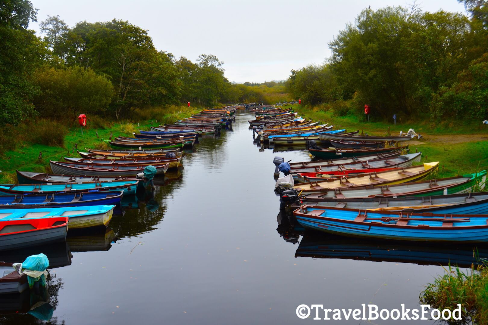A photo of at least 20 colorful fishing boats in Killarney, Ireland.