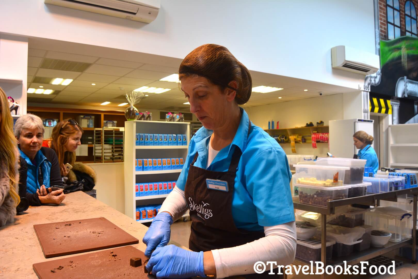 A lady explaining to us the different types of Chocolates made at Skellings chocolate factory