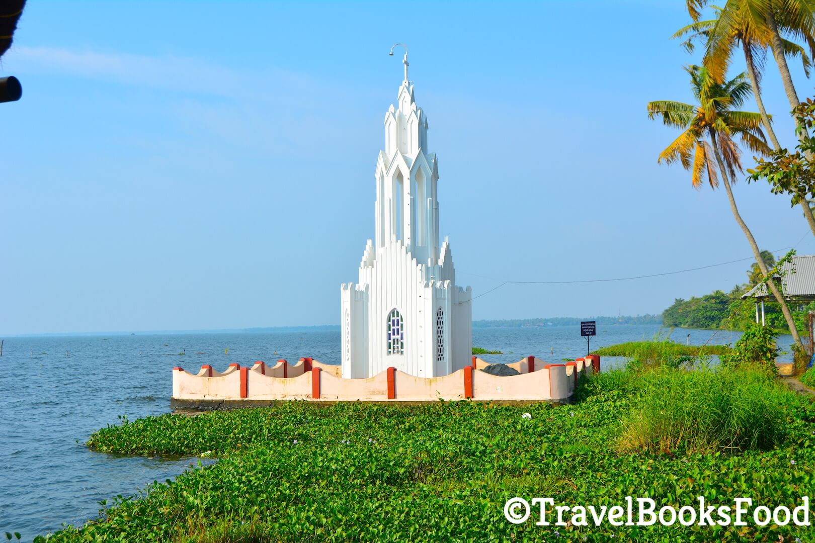 Photo of a White Church in Kummarakom, Kerala, India surrounded by water on all sides
