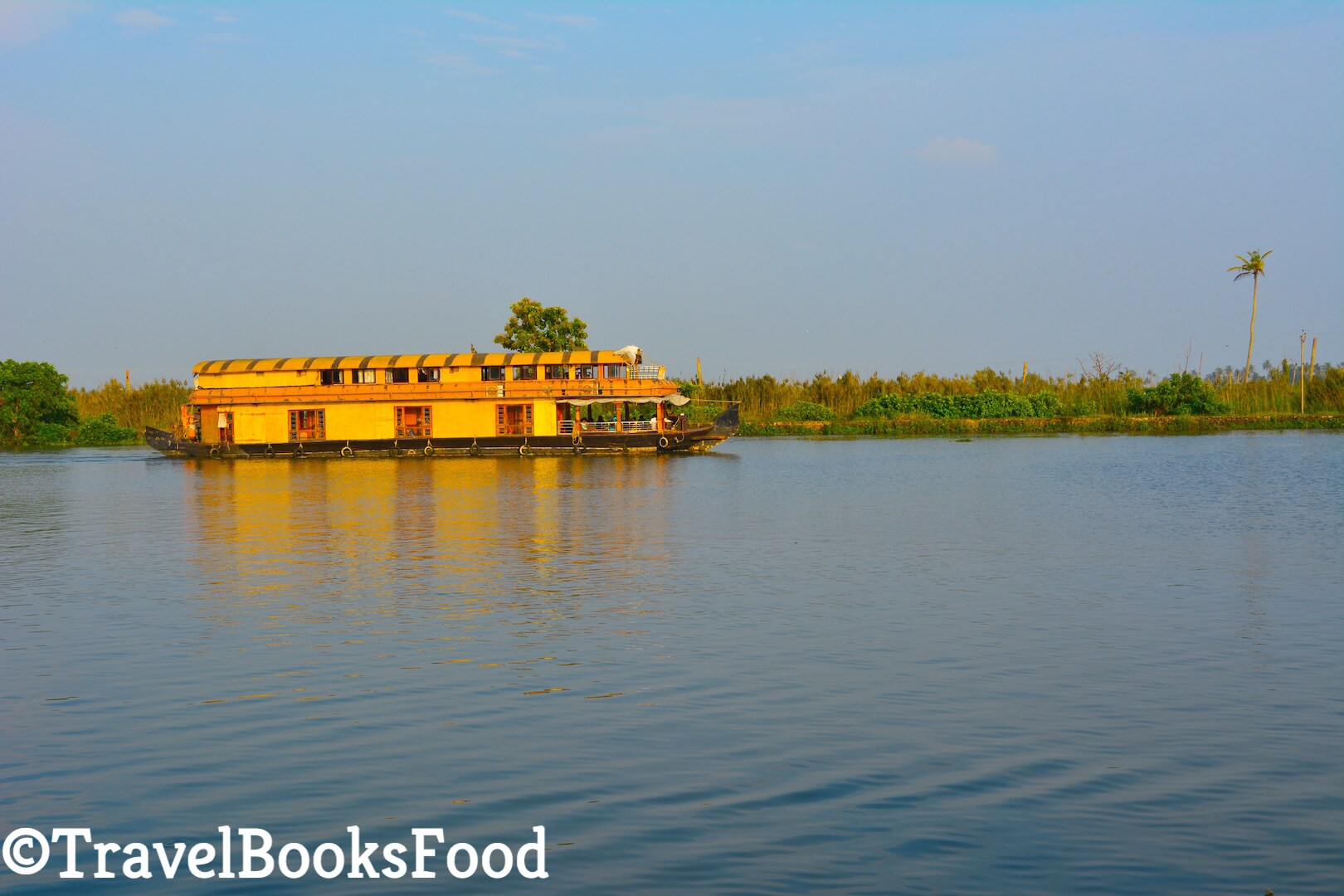 A picture of a houseboat taken in Kerala, India during sunset