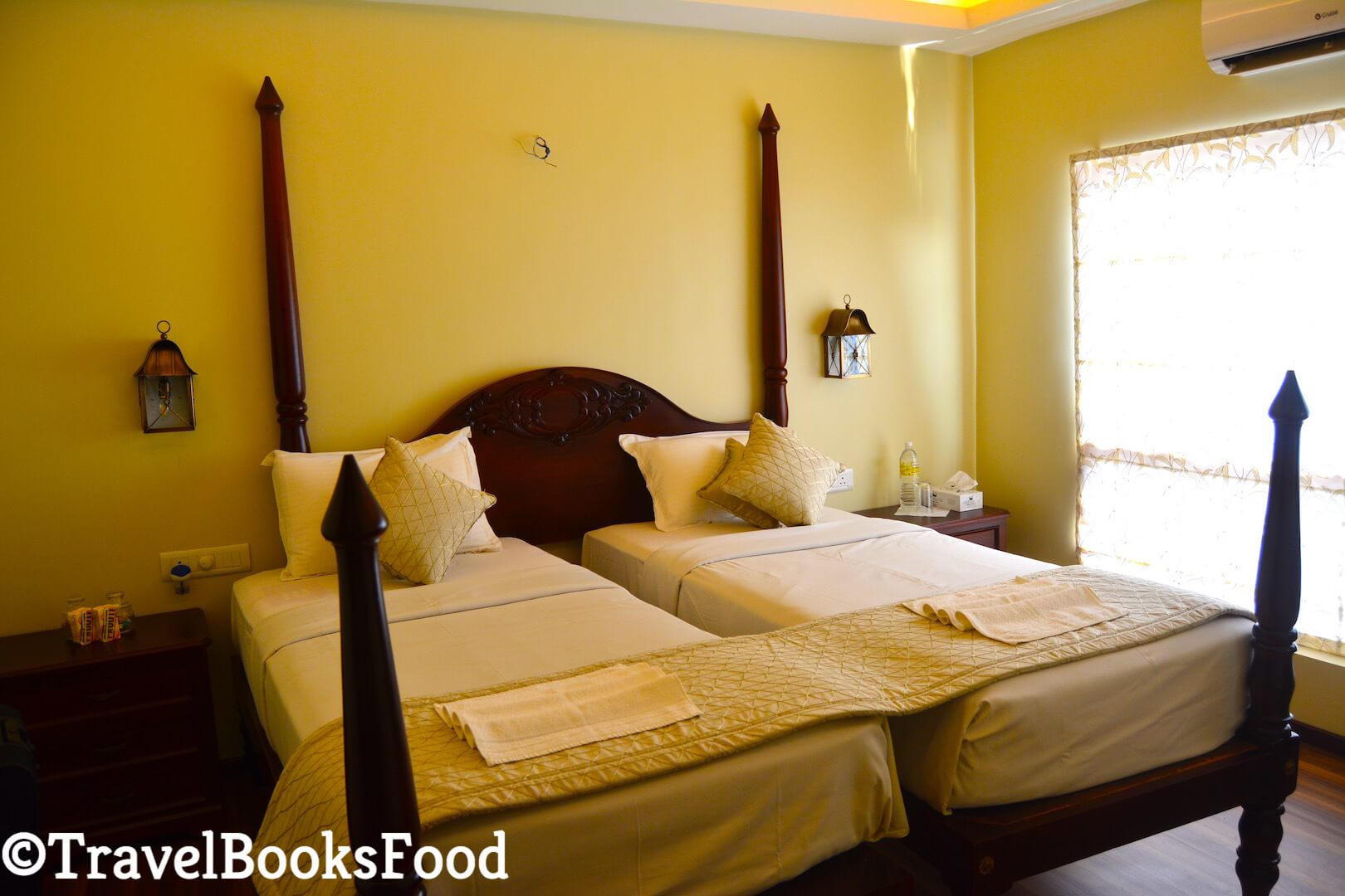 Photo of bedroom inside Spice Routes Luxury Houseboat in Kerala, India