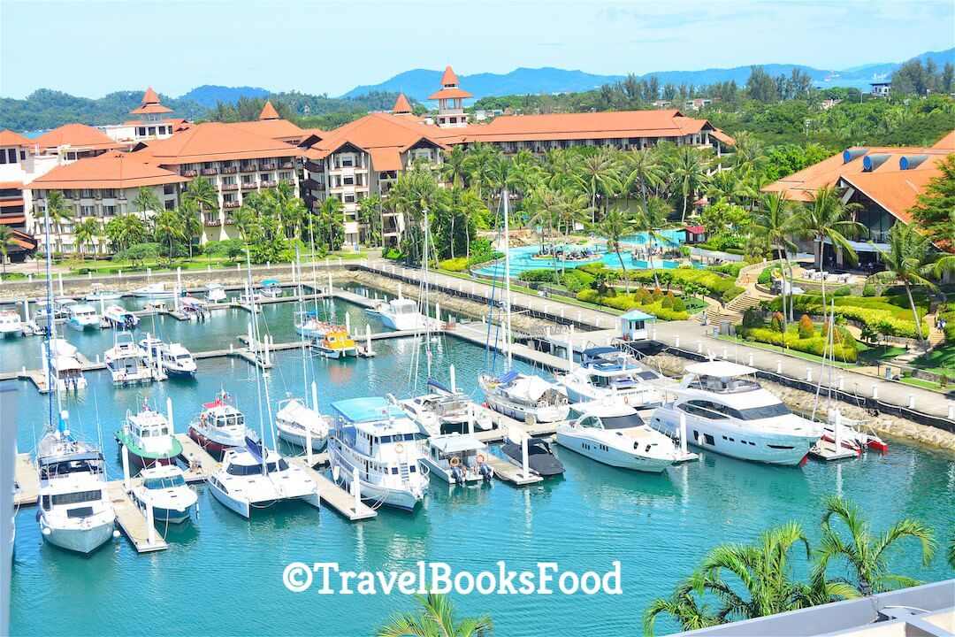 This is a photo of a harbour with many boats and a resort from a viewpoint high up in Malaysia