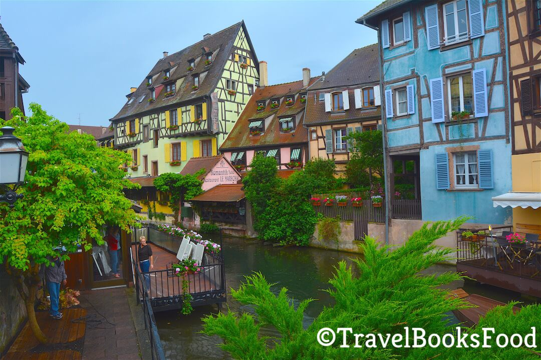 In this town, you will find the town of Colmar with its colourful timbered houses with a water body in front of it