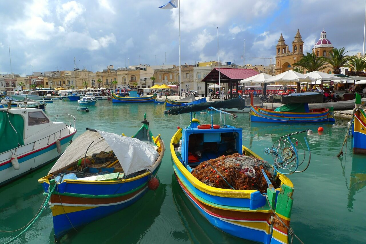 A colorful marina filled with lots of colourful boats in Malta
