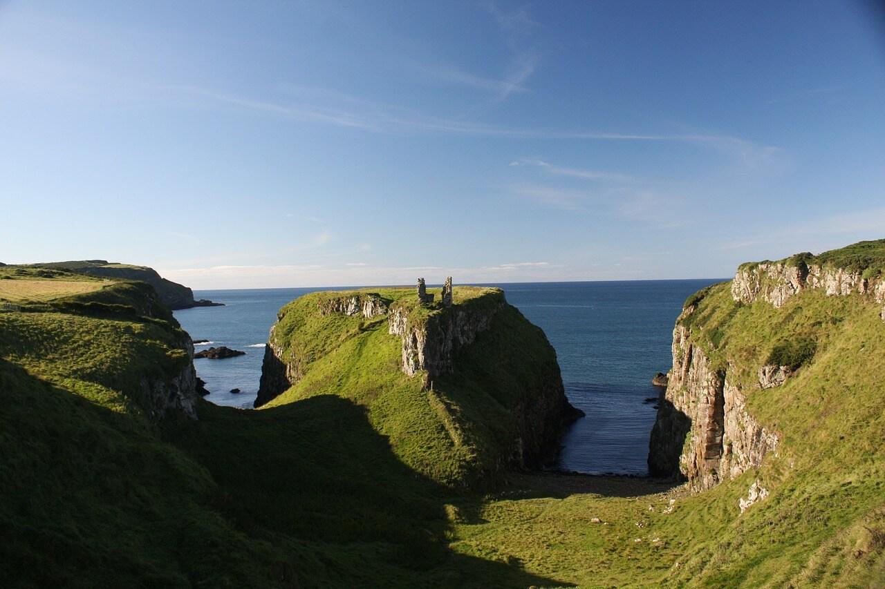 A photo of few green cliffs in Northern Ireland