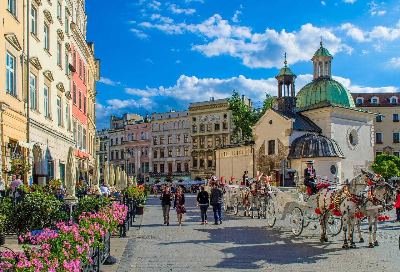 Old town in Poland with colorful buildings and few horse carriages