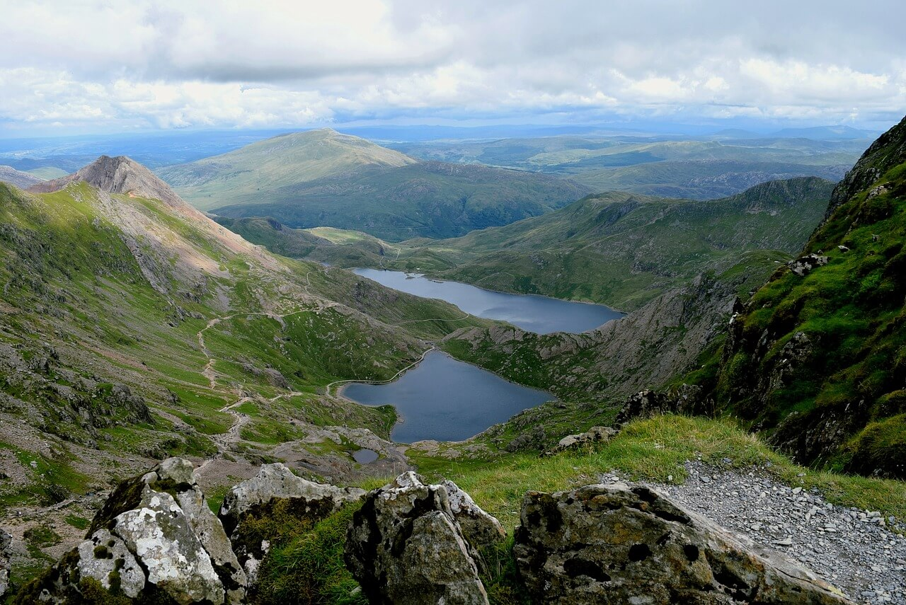 This is the photo of a green valley with two lakes between them in Wales