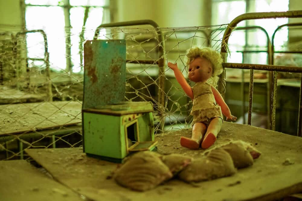 A photo of an abandoned doll in the ghost town of Pripyat