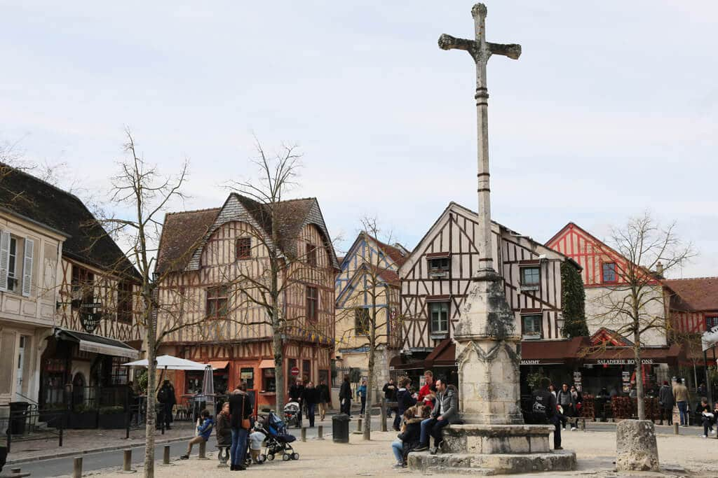 In this photo, you see a sqaure surrounded by timbered buildings