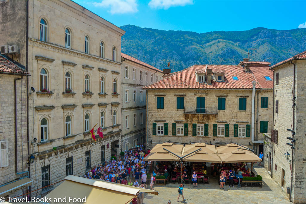 Th old town square of Kotor crowded with tourists from cruise ships