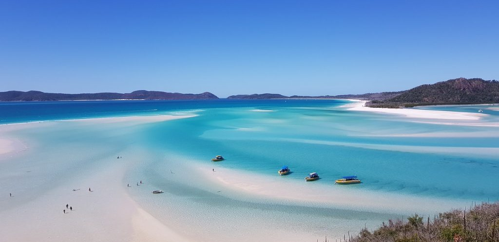 This is the picture of a really white sand beach with extremely gorgeous blue waters. Cover image of Australia visa for Indians post