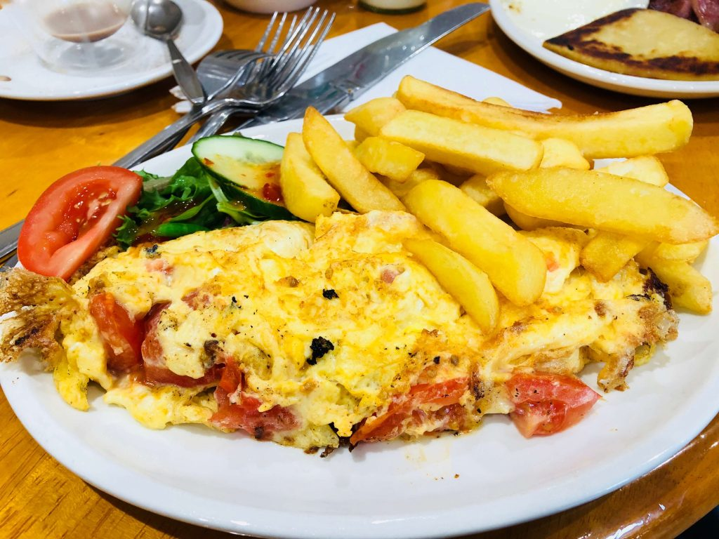 Scottish breakfast of Omelettes, French fries and salad