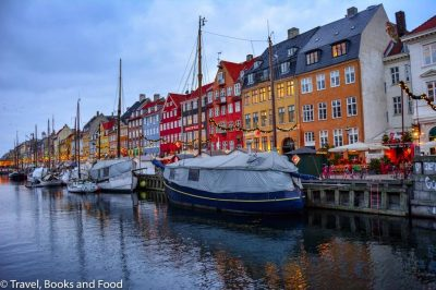 A view of the Nyhavn harbour with a row of colourful houses in Copenhagen, a must see European destination on your European itinerary