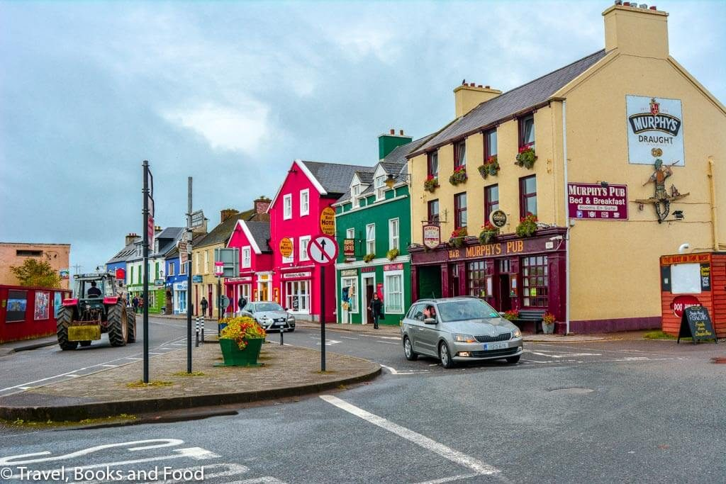 A street in the colourful town of Dingle in Europe with different coloured buildings