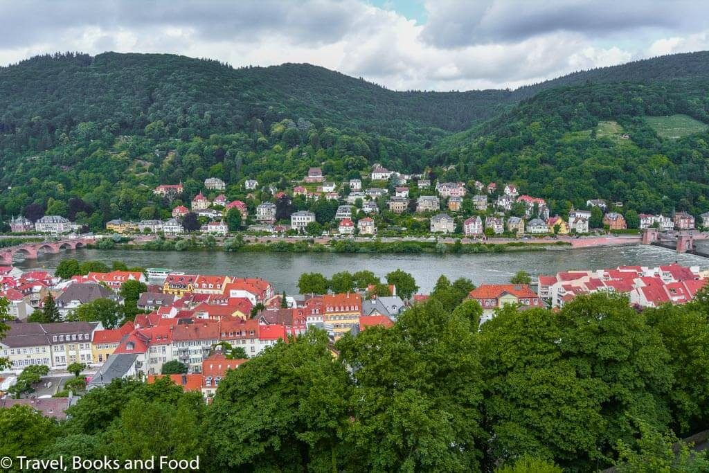 The pretty romantic European town of Heidelberg surrounded by lots of green mountains