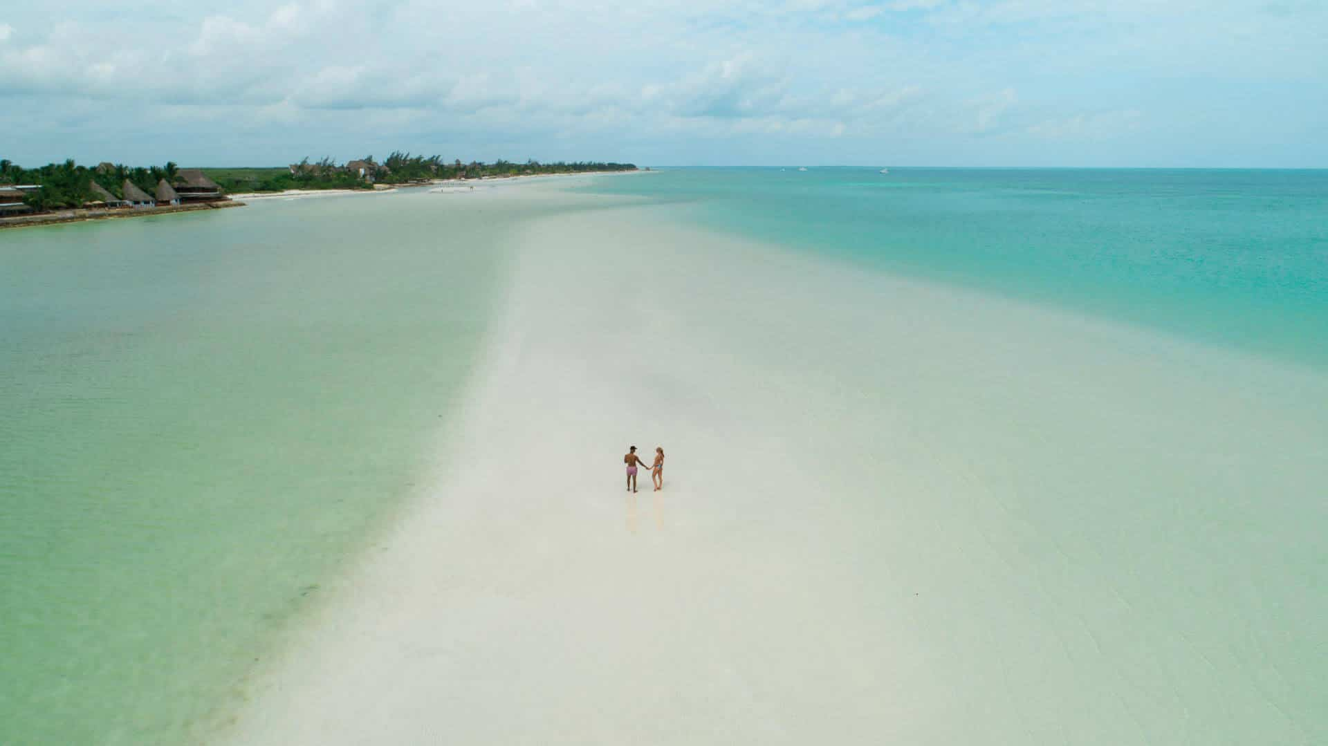 A drone shot couple on a sandbar in gorgeous Isla Holbox in Mexico