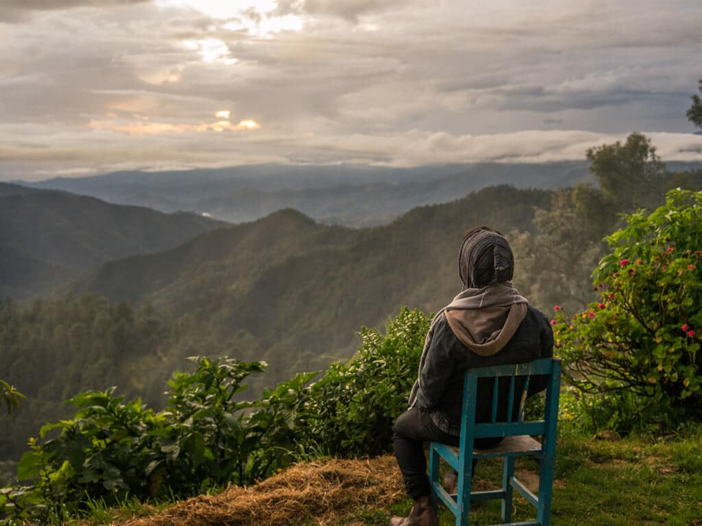 A man overlooking sunrise over the mountains