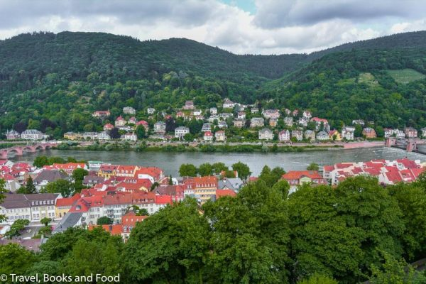 The pretty romantic city of Heidelberg surrounded by lots of green mountains