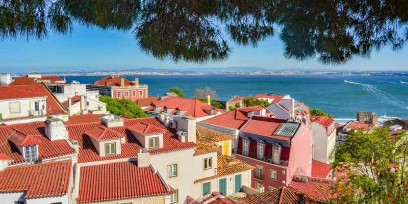 A view of Lisbon from top of San Jorge Castle with lots of brown tiled houses