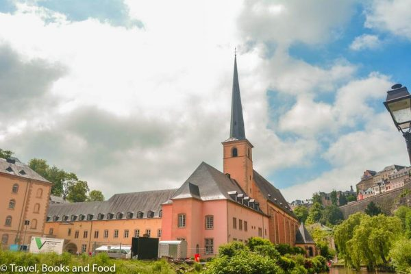 A building with a long spire in the capital of Luxembourg, a favorite European country