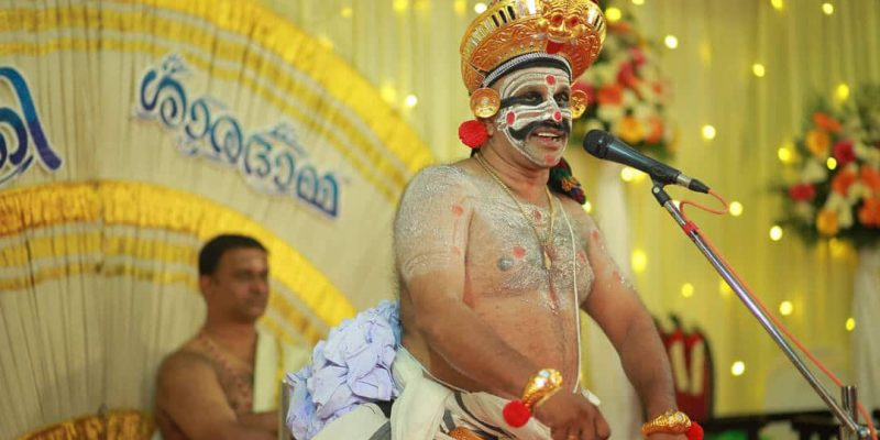 A man dancing with a face full of makeup in Kerala