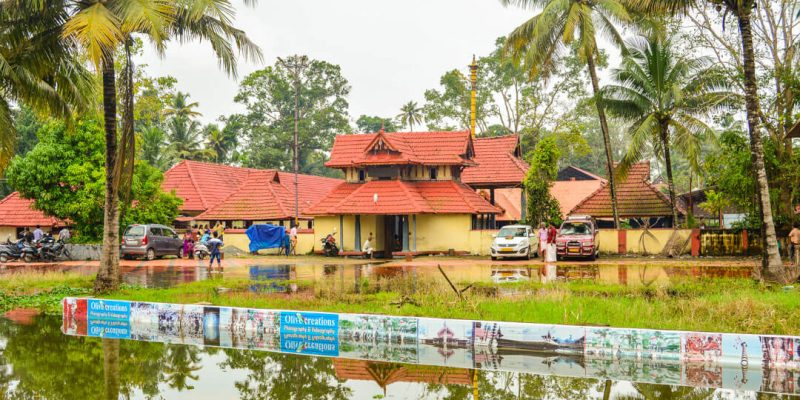 A temple with a red roof in Kerala: Human by Nature in Kerala